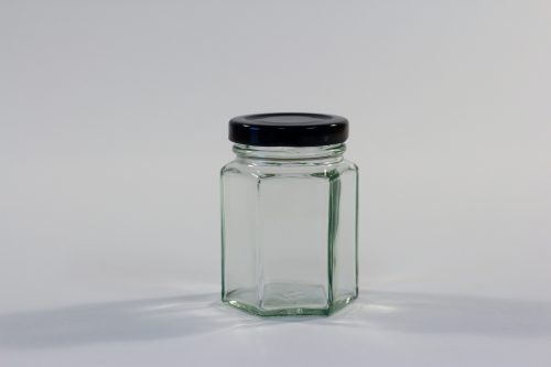 110ml Hexagonal glass jar with lid. Food grade packaging perfect for honey, jams, confectionarys and chutneys