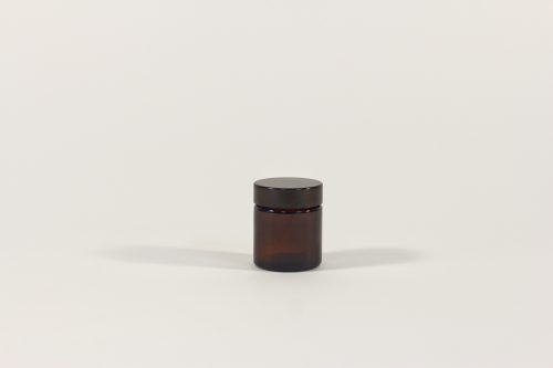 30ml amber glass jar with black lid. From our Glass packaging range.
