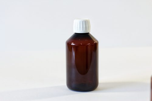 250ml amber PET Bottle with 28mm white lid. From our Pharmaceutical packaging range.