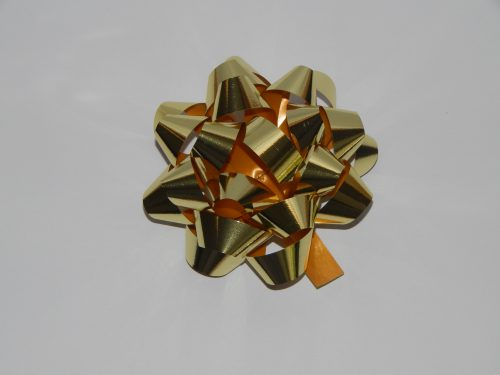 100mm Gold Metallic Stick On Bows on a White Back Drop.
