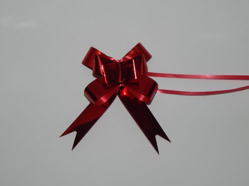 18mm Red pull string ribbons on a white backdrop. Christmas ribbons in different colours.