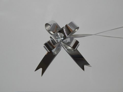 18mm silver pull string ribbon on a white back drop.